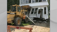 Ohio Man Steals Front-End Loader, Drives it Through a House